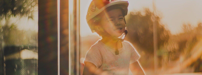 Slide 3 – Child With Helmet